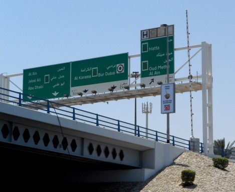 Dubai highway signs from the river.