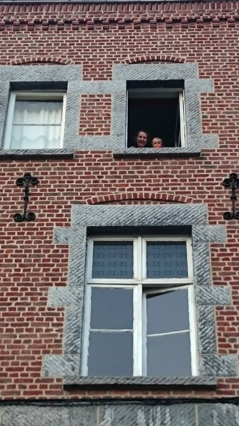 We knew it was our cue to head back when we saw Grandma and baby Paige saying hi out the window. (Belgium circa 2015)